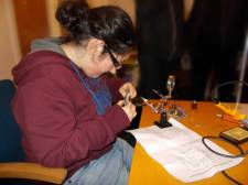 Steph solders the components